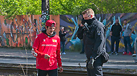 17th May 2020,Stadion An der Alten Försterei, Berlin, Germany; Bundesliga football, FC Union Berlin versus Bayern Munich;  A football fan awaiting the arrival of the teams is watched by a police officer