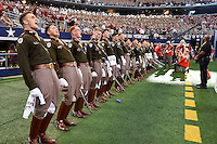 Members of Cadet Corp sing the Aggie War Hymn during NCAA Football game, Saturday, September 27, 2014 in Arlington, Tex. Texas A&M defeated Arkansas 35-28 in overtime. (Mo Khursheed/TFV Media via AP Images)