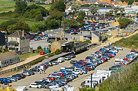 BNPS.co.uk (01202 558833)<br /> Pic: Graham Hunt/BNPS<br /> Date: 7th September 2021.<br /> <br /> The car parks are packed as sunbathers and visitors flock to the beach to enjoy the scorching hot sunshine at the seaside resort of West Bay in Dorset during a mini heatwave.