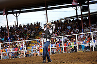 USA. Angola. 12th October 2008..A prisoner who lasted the longest during the bareback horse riding gestures to the crowd..©Andrew Testa/Panos