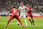 Real Madrid's Toni Kroos and Sevilla FC's Mariano Ferreira and Luciano Vietto during Copa del Rey match between Real Madrid and Sevilla FC at Santiago Bernabeu Stadium in Madrid, Spain. January 04, 2017. (ALTERPHOTOS/BorjaB.Hojas)