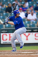 Iowa Cubs designated hitter Donnie Murphy (5) at bat against the Round Rock Express in the Pacific Coast League baseball game on July 21, 2013 at the Dell Diamond in Round Rock, Texas. Round Rock defeated Iowa 3-0. (Andrew Woolley/Four Seam Images)