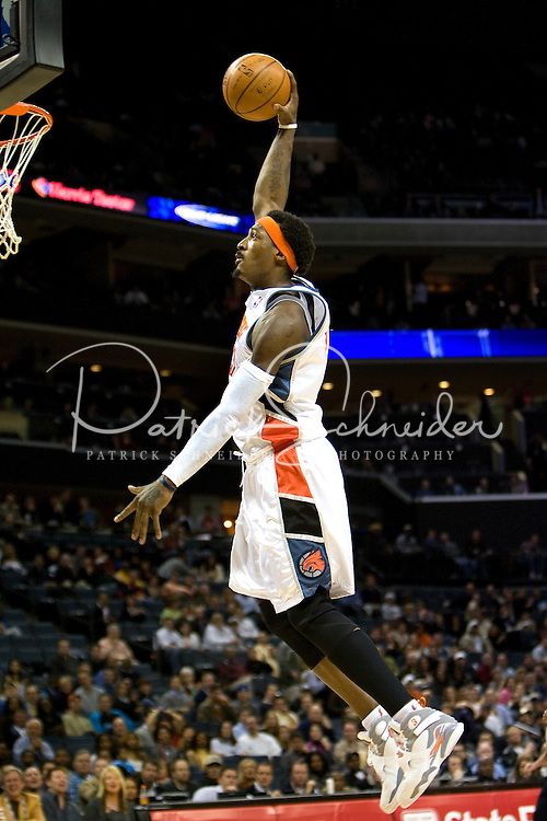 Charlotte Bobcats Gerald Wallace dunk the ball over the Dallas Mavericks during an NBA basketball game Time Warner Cable Arena in Charlotte, NC.