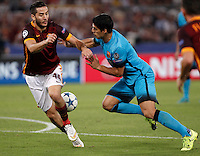 Calcio, Champions League, Gruppo E: Roma vs Barcellona. Roma, stadio Olimpico, 16 settembre 2015.<br /> Roma's Kostas Manolas, left, and FC Barcelona's Luis Suarez fight for the ball during a Champions League, Group E football match between Roma and FC Barcelona, at Rome's Olympic stadium, 16 September 2015.<br /> UPDATE IMAGES PRESS/Isabella Bonotto