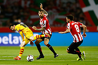 17th April 2021; Olmpico de La Cartuja stadium, Seville, Spain; Copa del Rey Football final, Athletic Bilbao versus FC Barcelona;  Lionel Messi of FC Barcelona challenged by Inigo Martnez and Unai Lopez of Athletic Club