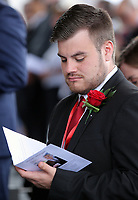 "Pictured: A Welsh Government employee reads the order of service. Wednesday 31 May 2017<br /> Re: The funeral for former first minister Rhodri Morgan has taken place in the Senedd in Cardiff Bay.<br /> The ceremony, which was open to the public, was conducted by humanist celebrant Lorraine Barrett.<br /> She said the event was ""a celebration of his life through words, poetry and music"".<br /> Mr Morgan, who died earlier in May aged 77, served as the Welsh Assembly's first minister from 2000 to 2009.<br /> He was credited with bringing stability to the fledgling assembly during his years in charge.<br /> It is understood Mr Morgan had been out cycling near his home when he died."