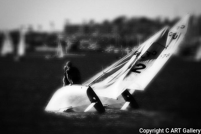 Sailboat keeling over, Newport Beach, CA.