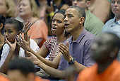 President Barack Obama and  first lady Michelle Obama react to a play as they, and daughters Malia Obama and Sasha Obama attend the Hawaiian Airlines Diamond Head Classic men's basketball game between the Oregon State Beavers and the University of Akron Zips at the University of Hawaii at Manoa Stan Sheriff Center, Sunday, December 22, 2013. The first lady's brother, Craig Robinson, is the Oregon State University Men's Head Basketball Coach.  <br /> Credit: Cory Lum / Pool via CNP