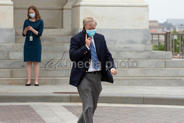 United States Senator Lindsey Graham (Republican of South Carolina) speaks on the phone as he leaves the United States Capitol in Washington D.C., U.S. on Thursday, May 21, 2020. Credit: Stefani Reynolds / CNP/AdMedia
