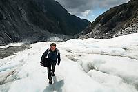 Tourist hiking on Franz Josef Glacier, Westland NP, West Coast, New Zealand