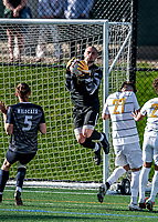 9 April 2021: University of Vermont Catamount Men's Soccer Goalkeeper Nate Silveira, a Senior from East Providence, RI, make a first-half save against the University of New Hampshire Wildcats at Virtue Field in Burlington, Vermont. The Catamounts fell to the visiting Wildcats 2-1 for their first loss of the season in America East, Division 1 play. Mandatory Credit: Ed Wolfstein Photo *** RAW (NEF) Image File Available ***