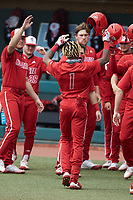 Terrell Tatum (1) of the North Carolina State Wolfpack is greeted by teammates after hitting a home run against the North Carolina Tar Heels at Boshamer Stadium on March 27, 2021 in Chapel Hill, North Carolina. (Brian Westerholt/Four Seam Images)
