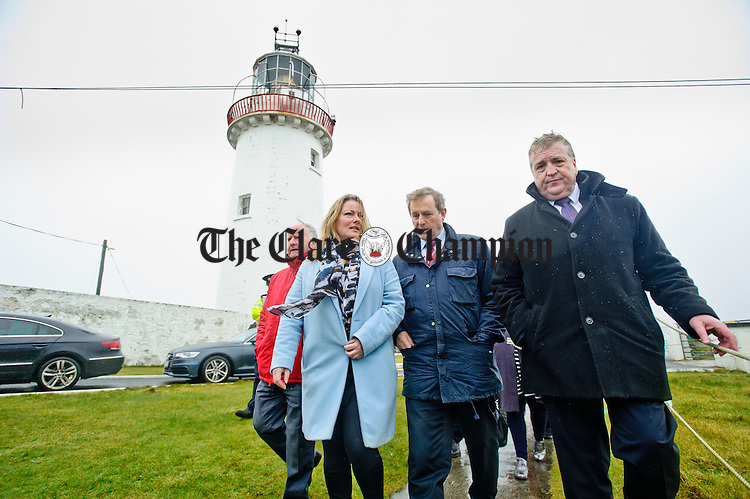 Enda Kenny, Taoiseach is escorted by Councillor Gabriel Keating, Councillor Mary Howard, Fine Gael candidate, and Pat Breen, TD during his visit to Loop Head to launch the Fine Gael tourism initiative. Photograph by John Kelly.