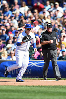Chicago Cubs first baseman Anthony Rizzo (44) fields a hopper in front of umpire Tim Welke during a game against the Milwaukee Brewers on August 14, 2014 at Wrigley Field in Chicago, Illinois.  Milwaukee defeated Chicago 6-2.  (Mike Janes/Four Seam Images)