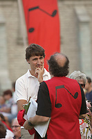 Liberal Party of Canada leader Justin Trudeau chats with a volunteer at the Festival de Musique Militaire in Quebec City, Wednesday August 21, 2013.<br /> <br /> PHOTO :  Francis Vachon - Agence Quebec Presse