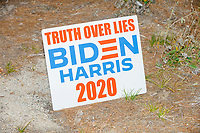 """A sign reading """"Truth over Lies / Biden Harris 2020"""" stands near cutouts of a bear and cubs by the roadside after Donald Trump, Jr., son of president Donald Trump and a rising Republican political star, spoke at an outdoor campaign rally at The Lobster Trap in North Conway, New Hampshire, on Thu., Sept. 24, 2020."""