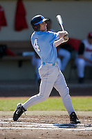 Garrett Gore (4) of the North Carolina Tar Heels follows through on his swing versus the St. John's Red Storm at the 2008 Coca-Cola Classic at the Winthrop Ballpark in Rock Hill, SC, Sunday, March 2, 2008.