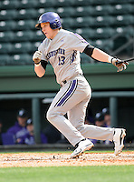 Infielder Colby Everett (13) of the Northwestern Wildcats hits in a game against the Furman University Paladins on Saturday, February 16, 2013, at Fluor Field in Greenville, South Carolina. The game was cancelled in the fifth inning due to snow. (Tom Priddy/Four Seam Images)