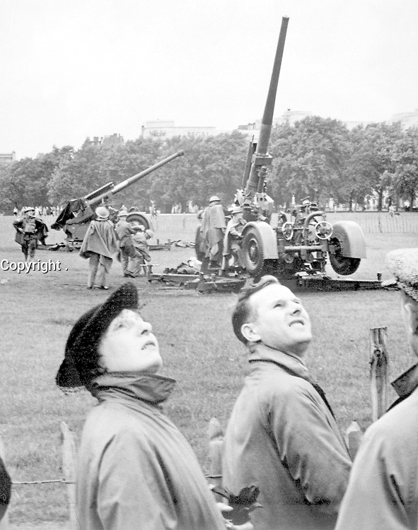 """Anti-aircraft guns in Hyde Park go into action as """"enemy bombers"""" make a daylight raid on London, during giant air defense exercises in which over 20,000 men and 1,300 RAF planes are taking part.  August 1939.  New York Times Paris Bureau Collection.  (USIA)<br /> Exact Date Shot Unknown<br /> NARA FILE #:  306-NT-901-73<br /> WAR & CONFLICT BOOK #:  1001"""