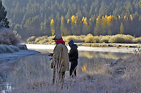 Two guys fishing on Deschutes River with fall color and fog. Central Oregon