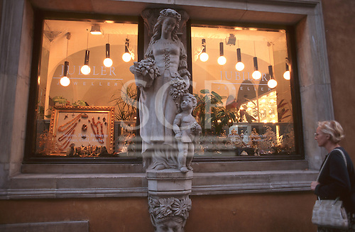 Warsaw, Poland. Jewellery shop with statue of a woman and child in medieval dress; Old Town.
