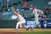 Tyler Hardman (36) of the Oklahoma Sooners stretches for a throw as Cole Austin (16) of the Arkansas Razorbacks steps on first base in game two of the 2020 Shriners Hospitals for Children College Classic at Minute Maid Park on February 28, 2020 in Houston, Texas. The Sooners defeated the Razorbacks 6-3. (Brian Westerholt/Four Seam Images)