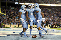 CHAPEL HILL, NC - NOVEMBER 02: Dyami Brown #2 of the University of North Carolina celebrates his first touchdown with teammates Javonte Williams #25 and Dazz Newsome #5 during a game between University of Virginia and University of North Carolina at Kenan Memorial Stadium on November 02, 2019 in Chapel Hill, North Carolina.