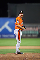 Aberdeen IronBirds relief pitcher Daniel Ayers (32) gets ready to deliver a pitch during a game against the Batavia Muckdogs on July 15, 2016 at Dwyer Stadium in Batavia, New York.  Aberdeen defeated Batavia 4-2.  (Mike Janes/Four Seam Images)