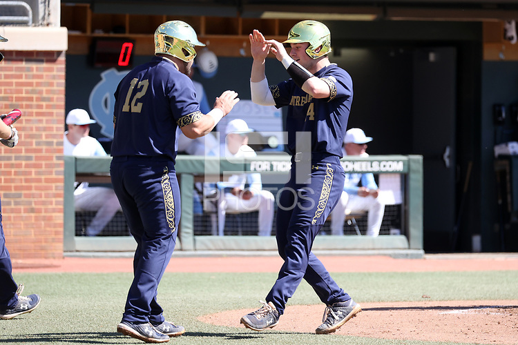 CHAPEL HILL, NC - MARCH 08: Zack Prajzner #14 and Niko Kavadas #12 of the University of Notre Dame celebrate after scoring runs during a game between Notre Dame and North Carolina at Boshamer Stadium on March 08, 2020 in Chapel Hill, North Carolina.