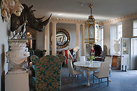An eclectic array of artefacts and furniture greets visitors in the neo-classical entance hall
