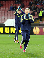 Thursday 27 February 2014<br /> Pictured: Swansea goalkeeper David Cornell (FRONT) followed by Gerhard Tremmel greet away supporters as he enters the picth to warm up before the game.<br /> Re: UEFA Europa League, SSC Napoli v Swansea City FC at Stadio San Paolo, Naples, Italy.