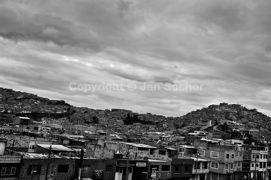 A view of a shanty town in the outskirts of the city, where a majority of house churches and religious communities are located, in Bogota, Colombia, 23 May 2010. Hundreds of Christian belivers, joined in nameless groups, gather every week in unmarked home churches dispersed in the city outskirts, to carry out prayers of liberation and exorcism. Community members and their religious activities are usually conducted by a charismatic pastor or preacher. Using either non-contactive methods (reading religous formulas from bible, displaying Christian symbols and icons) or rough body-pressure-points techniques and forced burping, a leading pastor commands the supposed evil spirit, which is generally believed to come from witchcraft, to depart a person's mind and body. The demon's expulsion often consists of multiple rites and may last for several months.