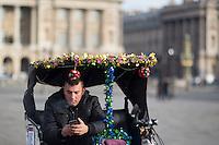 A velo taxi, concept based on the Asian rickshaw, waits tourists in the Place de la Concorde in Paris, France, December 21, 2016. # SECURITE RENFORCEE AU MARCHE DE NOEL DES CHAMPS ELYSEES A PARIS