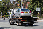 © Joel Goodman - 07973 332324 . 16/07/2017 . Manchester , UK . A silver BMW is towed from the scene . The Independent Police Complaints Commission have been informed following a road traffic accident near Stockport . Reports say a car struck two elderly people on the A6 Buxton Road in Heaviley at the junction with Kennerley Road and that two young males were detained by members of the public and police as they tried to make off from the scene . An undamaged silver BMW and a badly damaged dark grey Renault Clio were towed from the scene and surrounding roads have been closed to traffic as an investigation is carried out . Photo credit : Joel Goodman