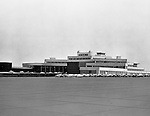 Pittsburgh PA: View of the parking lot at the Greater Pittsburgh Airport. In 1944, Allegheny County officials proposed to expand the military airport with the addition of a commercial passenger terminal in order to relieve the Allegheny County Airport, which was built in 1926 and whose capacity was quickly becoming insufficient to support the growing demand for air travel.  The new airport, christened as Greater Pittsburgh Airport opened on May 31, 1952. The first flight occurred on June 3, 1952.