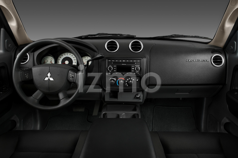 Straight dashboard view of a 2008 Mitsubishi Raider pickup truck