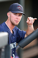 Outfielder Cole Brannen (5) of the Greenville Drive, No. 6 Red Sox prospect and 2nd Round draft pick, waits in the dugout before a preseason workout on Tuesday, April 3, 2018, at Fluor Field at the West End in Greenville, South Carolina. (Tom Priddy/Four Seam Images)