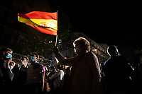 MADRID, SPAIN – MAY 04: A woman waves the Spanish flag in front of the PP headquarters as a sign of victory on 4 May in Madrid, Spain.  (Photo by Joan Amengual / VIEWpress via Getty Images)