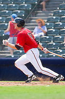 Roger Kieschnick #39 of the Richmond Flying Squirrels follows through on his swing against the Harrisburg Senators at The Diamond on July 22, 2011 in Richmond, Virginia.  The Squirrels defeated the Senators 5-1.   (Brian Westerholt / Four Seam Images)