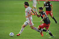WASHINGTON, DC - SEPTEMBER 12: Florian Valot #22 of New York Red Bulls battles for the ball with Junior Moreno #5 of D.C. United during a game between New York Red Bulls and D.C. United at Audi Field on September 12, 2020 in Washington, DC.
