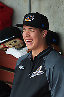 Akron RubberDucks pitcher Luis Lugo (48) in the dugout before a game against the Binghamton Rumble Ponies on May 12, 2017 at NYSEG Stadium in Binghamton, New York.  Akron defeated Binghamton 5-1.  (Mike Janes/Four Seam Images)