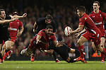 Wales number 8 Taulupe Faletau gets a pass away to set up a try for Rhys Webb.<br /> Dove men Series 2014<br /> Wales v New Zealand<br /> 22.11.14<br /> ©Steve Pope -SPORTINGWALES