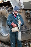 Checking specific gravity of suspension fertilser - Norfolk, February