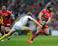 Matt Giteau of RC Toulon is tackled by Nick Abendanon of ASM Clermont Auvergne