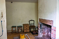 BNPS.co.uk (01202 558833)<br /> Pic: MaxWillcock/BNPS<br /> <br /> Pictured: A living room.<br /> <br /> An abandoned cottage that is covered by undergrowth and looks like something out of a horror film has sold for a whopping £430,000.<br /> <br /> The derelict property, called Grasshopper Cottage, had a valuation of £275,000 before it went up for sale at auction.<br /> <br /> But due to the current state of the property market where demand far outstrips supply, interest and bidding in the 150-year-old cottage took off.