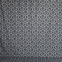 Patterned backdrop featuring gray and fine black scalloped Victorian pattern