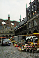 Lubeck: Marktplatz, N. Rathaus in dark glazed brick from 1250. Onwards, note round openings and turrets with snuffer tops. Photo '87.