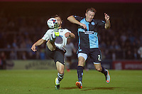 Nikolay Bodurov of Fulham clears under pressure from Garry Thompson of Wycombe Wanderers during the Capital One Cup match between Wycombe Wanderers and Fulham at Adams Park, High Wycombe, England on 11 August 2015. Photo by Andy Rowland.