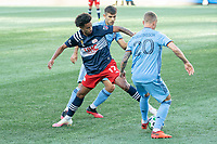 FOXBOROUGH, MA - SEPTEMBER 19: Gudmundur Thorarinsson #20 of New York City FC passes the ball as Tajon Buchanan #17 of New England Revolution reaches for it during a game between New York City FC and New England Revolution at Gillette on September 19, 2020 in Foxborough, Massachusetts.
