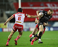 20th November 2020; Totally Wicked Stadium, Saint Helens, Merseyside, England; BetFred Super League Playoff Rugby, Saint Helens Saints v Catalan Dragons; Sam Tomkins of Catalan Dragons evades a tackle from Jonny Lomax of St Helens